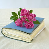 Small roses on a diary. Bouquet of small roses on a diary, sketchbook Royalty Free Stock Images