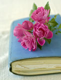 Small roses on a diary. Bouquet of small roses on a diary, sketchbook Stock Image