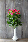 Small roses in a vase Royalty Free Stock Photo