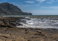 A small rough sea at Cape Frenchwoman. Royalty Free Stock Images
