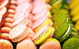 Small round cakes macaroons with a creamy filling. Colorful confetti with original flavors. A favorite delicacy all over the world royalty free stock image