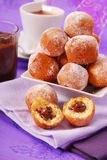 Small round donuts with chocolate filling Royalty Free Stock Photography