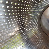 Small round holes in a thin metal sheet Stock Photography
