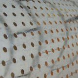 small round holes in a thin metal sheet Stock Images