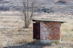 Small round lonely stone structure in the steppe royalty free stock photos