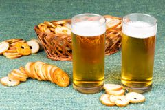Small round mini bake rolls with beer. Small round mini bake rolls with a hole inside with beer Stock Images