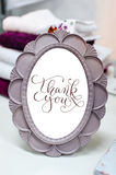 Small round mirror in a frame with letters thank you Royalty Free Stock Photos