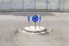 A small roundabout with 4 mandatory rotation signals Royalty Free Stock Photos
