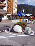 Small roundabout with stones and flowers in Madonna di Campiglio Royalty Free Stock Images