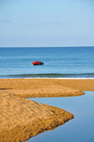 Small Rowboat on a beach Stock Photo