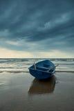 Small rowboat on beach Stock Photo