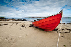 Small rowboat lying at shore Royalty Free Stock Photo