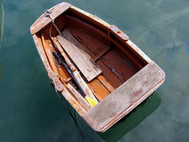 Small rowing boat. The small Maltese rowing-boat moored at the Port of Marsaxlokk and the single plastic oar Royalty Free Stock Images