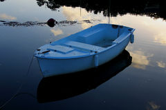 Small rowing boat on calm water Royalty Free Stock Image