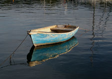Small rowing boat on calm water Stock Images