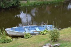 Small rowing boat lying to the edge stock photography