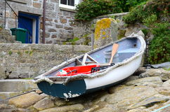 Small rowing boat. A small rowing boat at Mousehole in Cornwall Stock Photos
