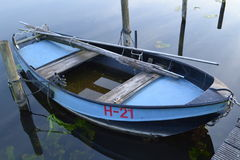 Small rowing boat in water Royalty Free Stock Photos