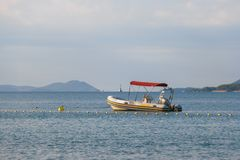 Small rubber motor boat, dinghy in morning light royalty free stock photo