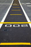 Small runway on the deck of aircraft carrier Royalty Free Stock Photo