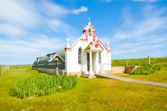 Small rural church in the countryside - The italian chapel, UK Stock Photo