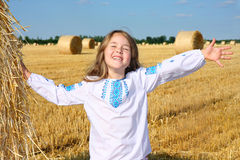 Small rural girl on harvest field Stock Photo