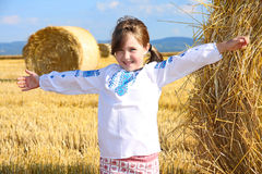 Small rural girl on harvest field Stock Photography