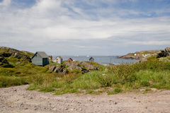Small rural ocean town. Small town on the Bonavista peninsula with icebergs in the background Stock Photography