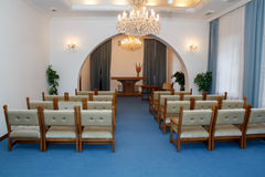 Small ruralwedding ceremony room with chandelier Royalty Free Stock Images