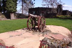 Small Rusted Cannon Protects This Beautiful Landscape. This small rusty cannon looks as if it is standing guard on these beautiful grounds Royalty Free Stock Image