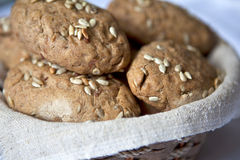 Small rye loafs with sunflower seeds. Close-up photo of little rye breads with sunflower seeds on top Stock Photos