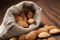 Small sack bag full of almonds Royalty Free Stock Images