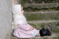 The small sad girl in a white kerchief Stock Photo
