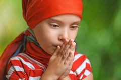 Small, sad little girl looking down Stock Photo