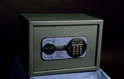 Small safe with a combination lock. Safe with digital combination lock royalty free stock photo