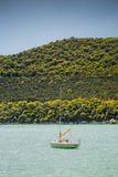 Small sail boat on lake Abrau Royalty Free Stock Image