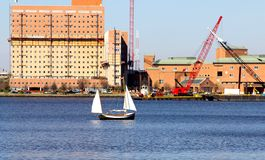 Small sail boat Sailing through Norfolk Virginia Royalty Free Stock Photo