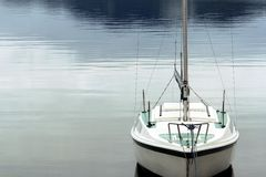 Small Sailboat. At the shore on a calm morning at Harrison Lake, BC stock photos