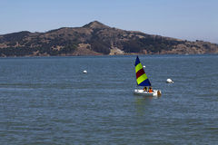 Small sailboat on bay two young boys Royalty Free Stock Photo