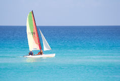 Small sailboat in a calm blue sea Stock Photography