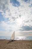 Small sailboat on a cart at the beach Royalty Free Stock Photo