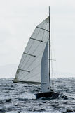 Small Sailboat with Full Sails in the Wind Royalty Free Stock Images