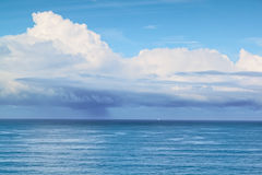 Small sailboat at sea before the storm. Stock Photography