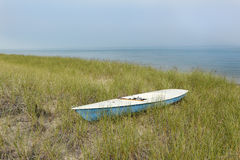 Small Sailboat Sitting in Dune Grass Next to Lake Huron Royalty Free Stock Photos