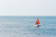 Small sailboat on water Stock Photography
