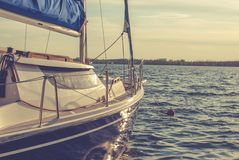 Small sailboat. On the water Royalty Free Stock Photos