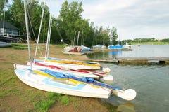 Small Sailboats. A row of small sailboats on the lake shore stock photography