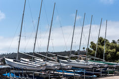 Small sailboats. At aluminum boat storage rack Royalty Free Stock Images