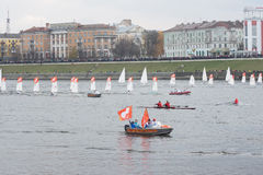 Small sailboats in the Olympic torch relay Royalty Free Stock Photos
