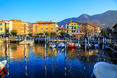 Small sailboats at the port in Iseo, Italy Stock Photos